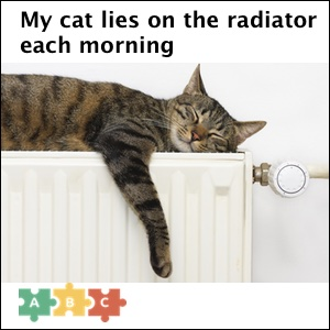 puzzle_cat_lies_on_the_radiator